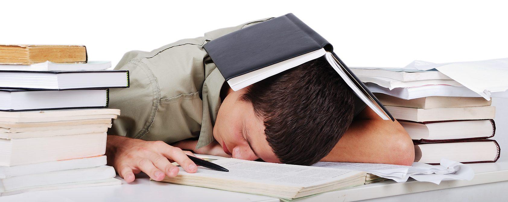 Young man fallen asleep after long reading